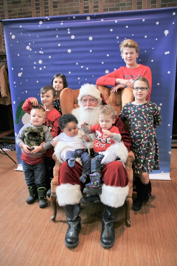 "On Santa's lap is Isaac Ally and Oliver Crisp. Children from left Jase Mintz, Ben Crisp, Grace Gregory, Colin Clayton, and Elise Gregory. Notice the ""I'm on the nice list"" t-shirts"