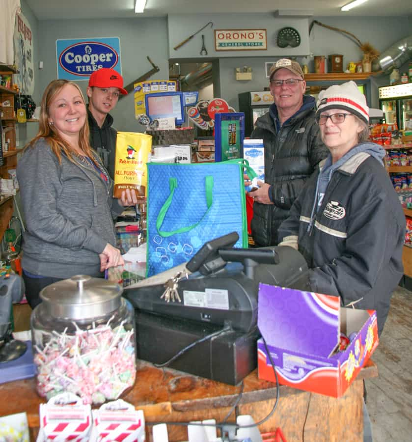 4. Orono General Store owner Tammy Rendell and son Devyn Boricic serve customers Larry Dickinson buying Kawartha Dairies milk and Leskard resident Donna Grant