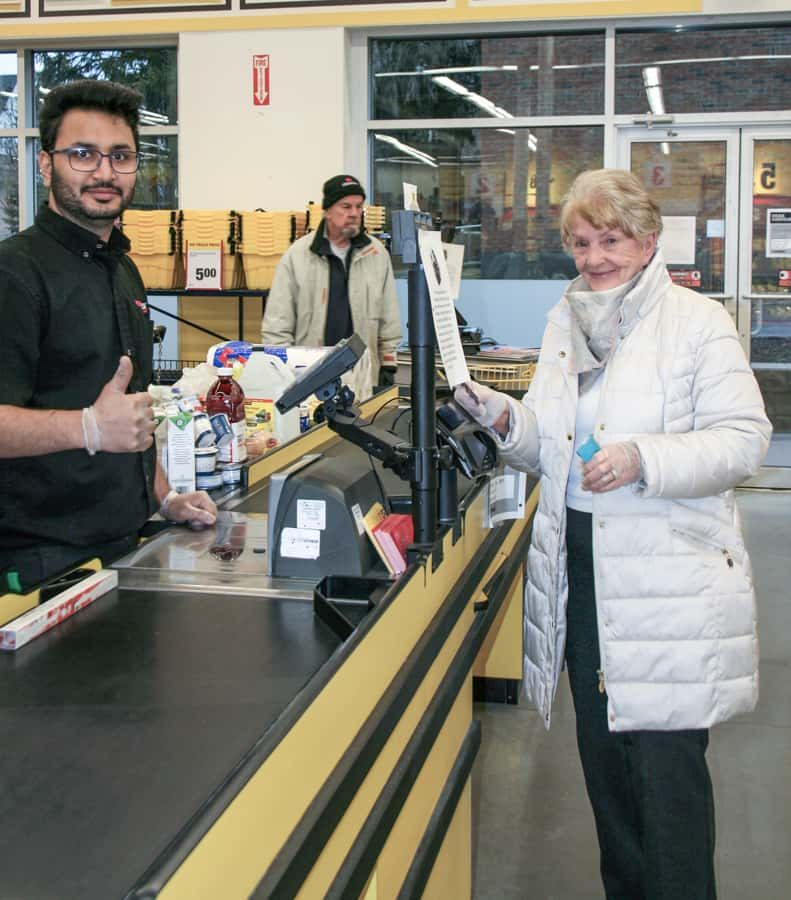 Cashier Harsh Patel working the front lines