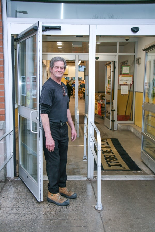Gary Matchett, produce manager welcoming customers
