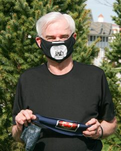 Who is the man behind the mask?